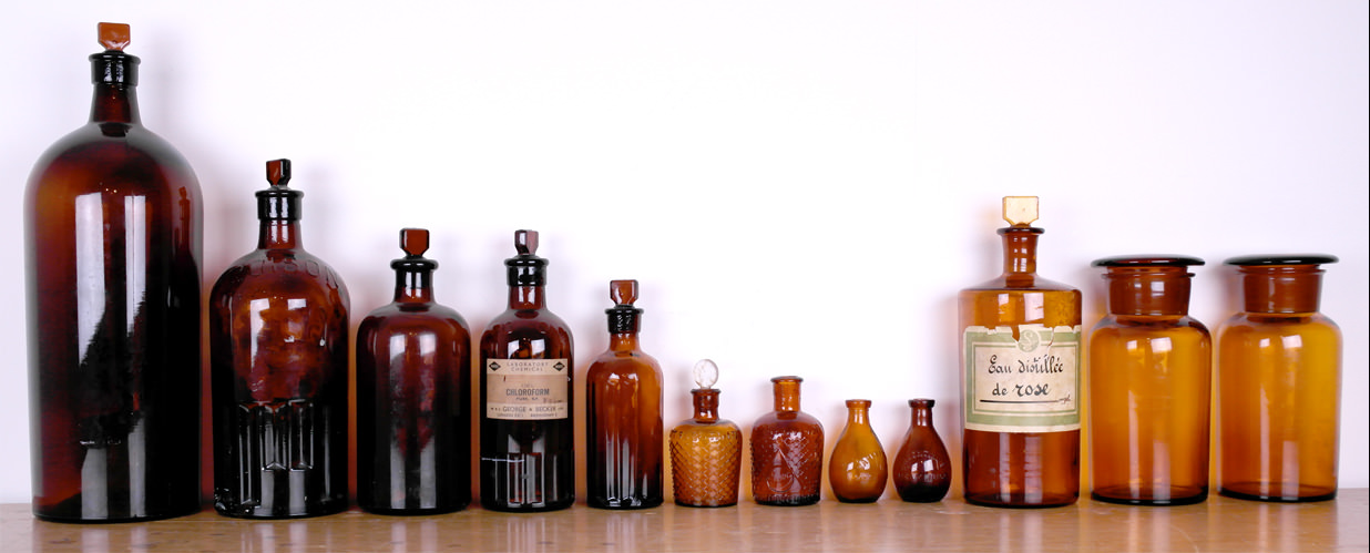 Vintage brown poison and chemists bottles