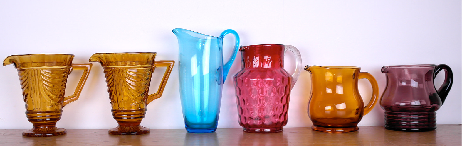 Vintage amber, cranberry & amethyst glass jugs