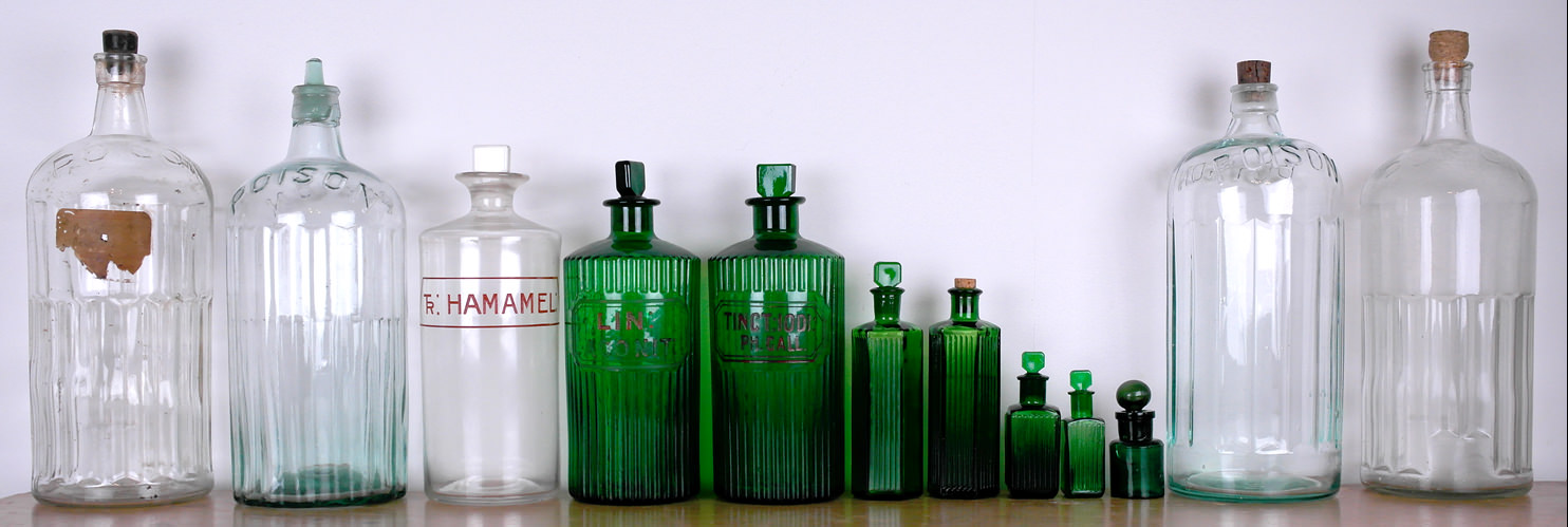 Vintage poison and chemists bottles